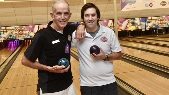 Bowl-O-Rama General Manager Andrew Maderios and son Bart get ready to welcome front line workers to a night of free bowling.