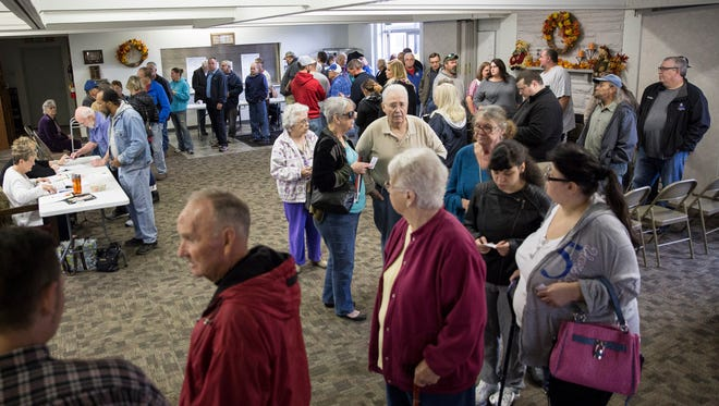 Voters wait in a long line both inside and outside precinct 53 and 54 at the Yorktown Church of the Nazarene Tuesday during election day. Yorktown saw the heaviest voter turnout with wait times over an hour at polling places.