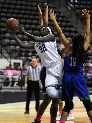 Abilene Christian's Lizzy Dimba (32) lays in a shot past Texas A&M Corpus Christi's Brittany Mbamalu (15) during the first quarter of the Wildcats' 72-64 win on Wednesday, Feb. 22, 2017, at ACU's Moody Coliseum.