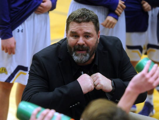 Wylie coach Gregg Ruffin talks to his team during a
