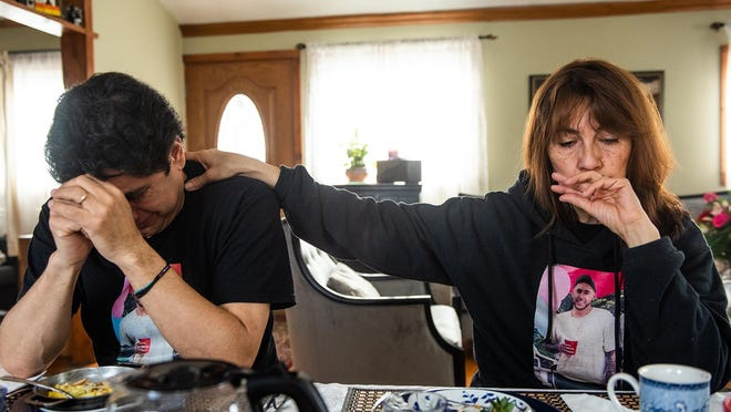 Consuelo Medina-Avilan, right, comforts her husband, Byron Avilan, as he talks about his son Sebastian Eduardo Avilan-Medina at their home in Circleville on Sunday. Avilan-Medina was killed at his Middletown home on March 11, 2019, and his killer has yet to be found.