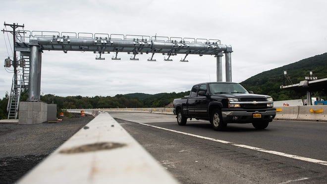 A truck drives under the New York State Thruway northbound cashless toll gantry in Central Valley.