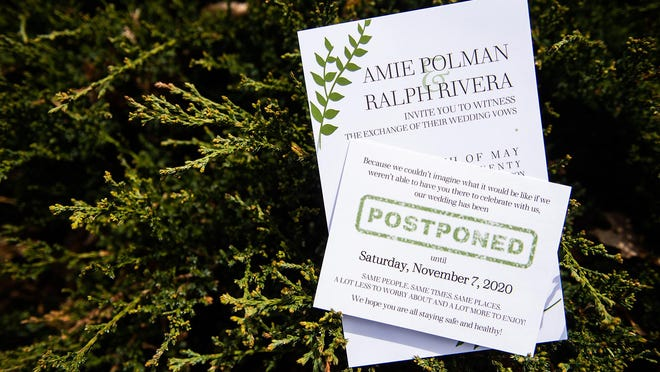The wedding invitation and postponement card for Amie Polman and Ralph Rivera's wedding. Their wedding, which was originally supposed to be held on May 16, has been postponed to November due to COVID-19.