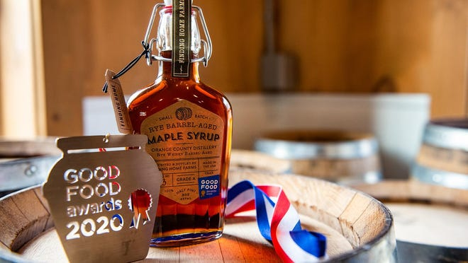 Finding Home Farms in Middletown produces award-winning syrup. Here a bottle of Rye-Barrel Aged Maple Syrup stands on display with the award medal from the Good Foods Award at Finding Home Farms. The syrup is aged in oak made rye whiskey barrels from Orange County Distilllery.