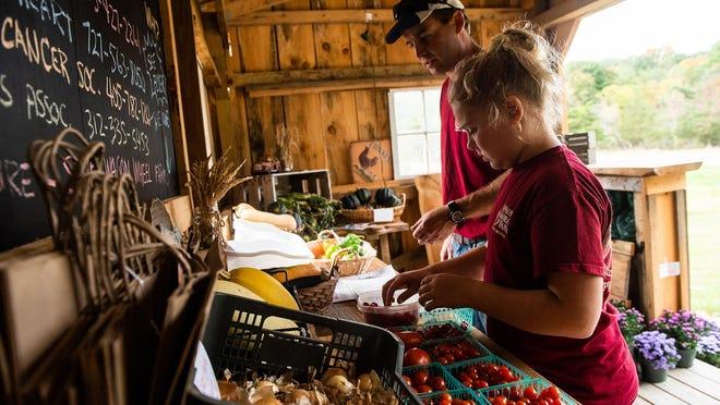 Baylie Touw with father Jason Touw at Wagon Wheel Farm in the Town of Goshen. Jason and wife Kristin recently reached an agreement in principle to buy Wagon Wheel Farm.