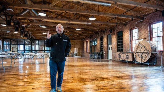 Michael Dorf, president and CEO of City Winery, talks on March 13 about the restoration of the ceiling and floors in the event space at the new business in the Village of Montgomery.