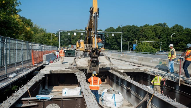 Construction crews rip out old panels of roadway to make way for new panels on the south span of the Newburgh-Beacon Bridge in 2015.