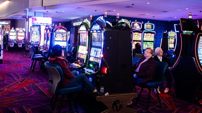 Patrons play the slot machines at Resorts World Catskills. Resorts World's losses have steadily decreased after the initial two-year start-up period.