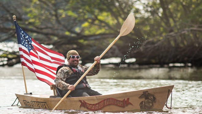 Marine veteran Matthew Russell paddles down the Rondout Creek in his own handmade wooden kayak en route to the Hudson River Maritime Museum in Kingston Sept. 15.