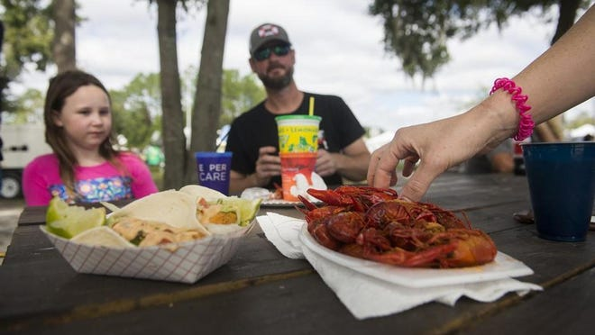 The 2020 Ogeechee Seafood Festival, planned for Nov. 6-8 in Richmond Hill, is canceled this year because of the COVID-19 pandemic. Shown: The Meeks family enjoys their seafood meal at the 2019 festival.