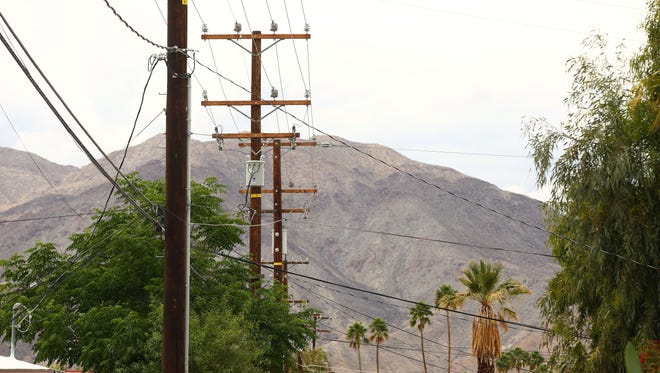 Utility poles and wires line the view of a Palm Desert neighborhood, as seen from Panorama Drive. on Monday, April 11, 2016.