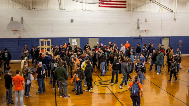 Teams gather to get a close look at field elements during a reveal of the FIRST Robotics competition challenge Saturday, Jan. 7, 2017, at Capac High School.