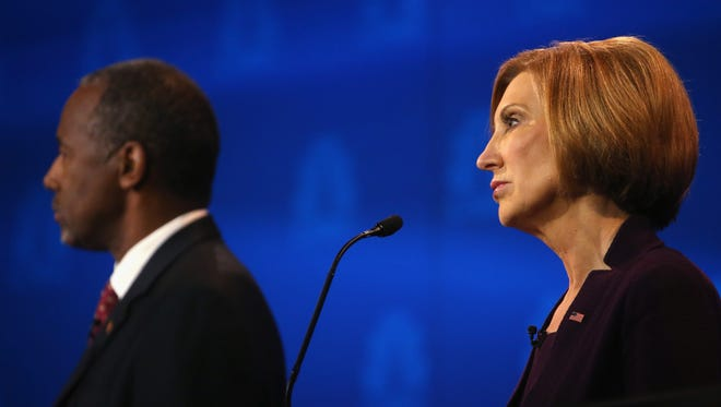 Ben Carson and Carly Fiorina at an Oct. 28, 2015, GOP debate in Boulder, Colo.