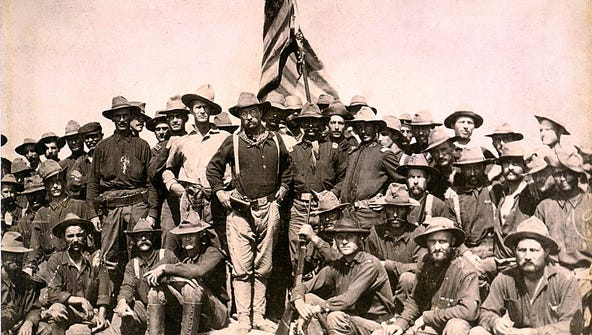 Colonel Roosevelt and his Rough Riders at the top of
