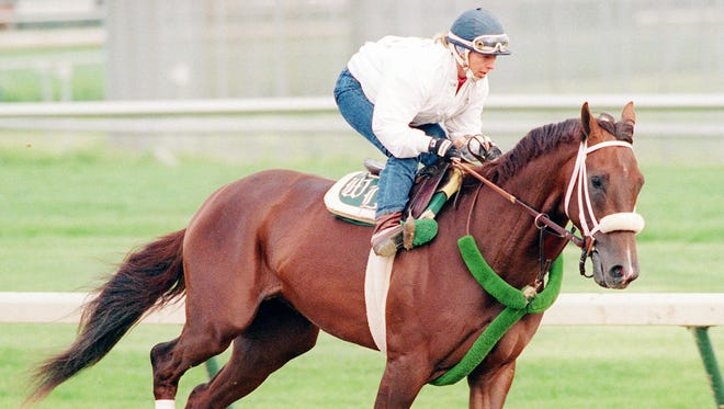 Kentucky Derby entry Timber Country is ridden around the track at Churchill Downs by exercise rider Joanne McNamara Thursday, May 4, 1995.
