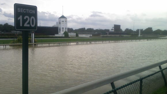 Torrential rains in Louisville left Churchill Downs' main track resembling a lake on Aug. 4, 2009.