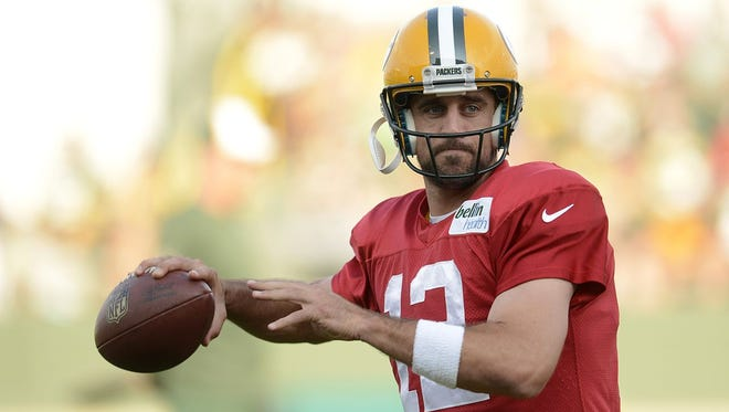 Green Bay Packers quarterback Aaron Rodgers runs drills during training camp practice at Ray Nitschke Field on Monday, Aug. 4, 2014.