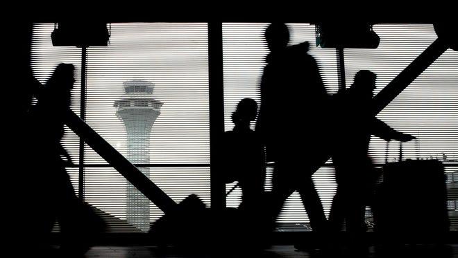 Travelers walk through Terminal 3 at Chicago's O'Hare International Airport on Nov. 23, 2016.