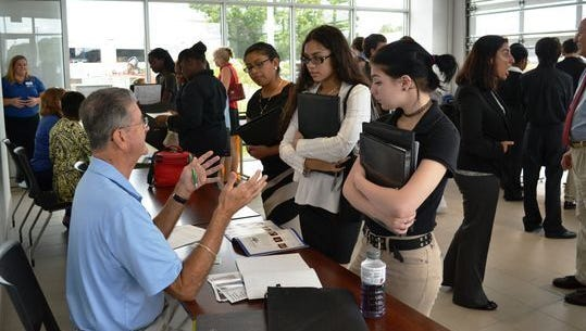 Young people meet with employers at last year's job fair.