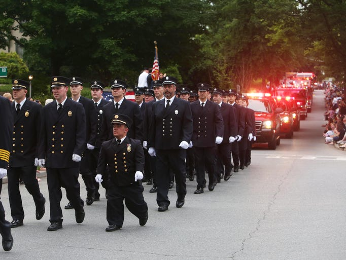Katonah firefighters proudly march along the streets of downtown Katonah during their annual parade June 4, 2014. Several departments from around the region took part.