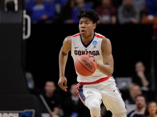 Gonzaga's Rui Hachimura moves the ball against UNC-Greensboro in last year's NCAA Tournament.