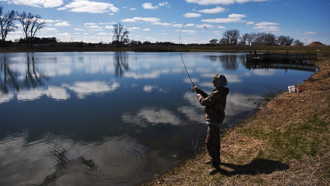 Lane Broker, 16, of Sioux Falls, casts his line into Family Park Lake Sunday, March 20, 2016, while fishing at Family Park in Sioux Falls.