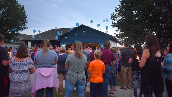 Friends and family release balloons into the air during Jenna Benzel's memorial. Jenna's favorite color was blue.