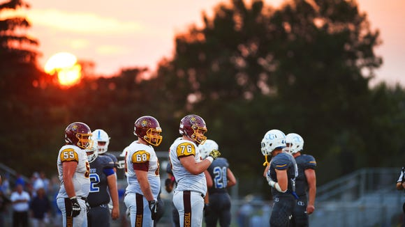 Harrisburg and O'Gorman players take the field Saturday