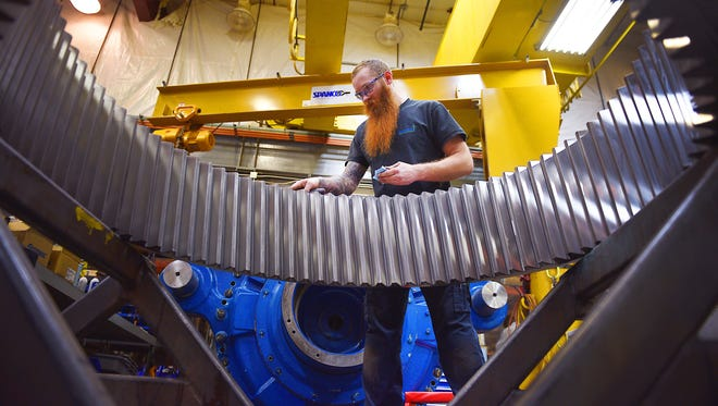 Assembly technician Ryan Rakstad puts a sealant between two housing halves on a ring gear at Renew Energy Thursday, Dec. 14, in Sioux Falls.