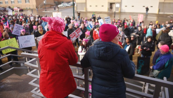 Dr. Amy Kelley and Planned Parenthood employee Jean Behr look over the crowd before the Women's March Saturday, Jan. 20, in downtown Sioux Falls.