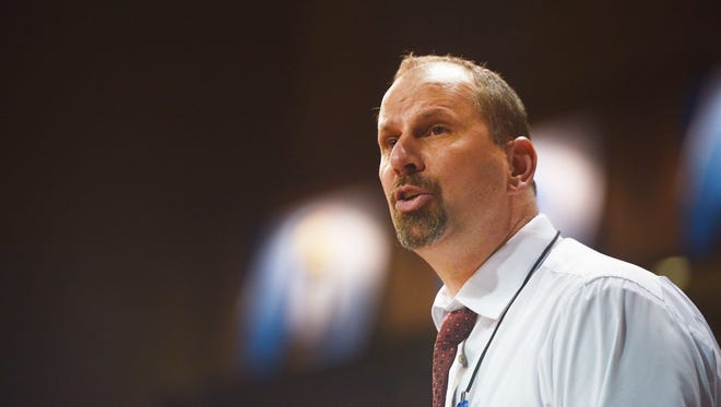 Northern State's Paul Sather talks to the team during the game against Queens Thursday, March 22, at the Sanford Pentagon in Sioux Falls.