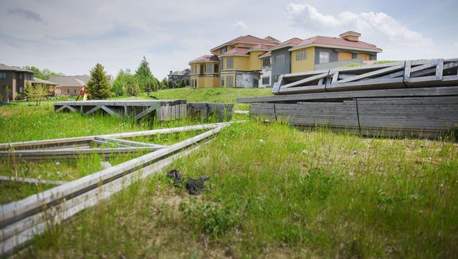 Building materials are sprawled out behind a seemingly-abandoned mansion Wednesday, May 23, in southern Sioux Falls.