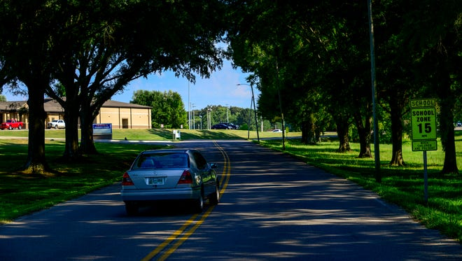 Cars drive down the road at Wilson Street in Paris, Tenn., Wednesday, July 25, 2018. The stretches of road between Lankford Road, Patriot Avenue, and Wilson Street will be renovated including the addition of sidewalks using money from a grant from the Tennessee Department of Transportation (TDOT) amounting to over 800 thousand dollars.