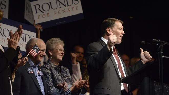 Mike Rounds celebrates winning a U.S. Senate seat Tuesday at a Republican election night party at The District in Sioux Falls, Nov 4, 2014.