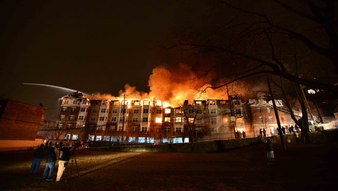 The fire at the Avalon at Edgewater, along the Hudson in New Jersey, burns on Jan 21.