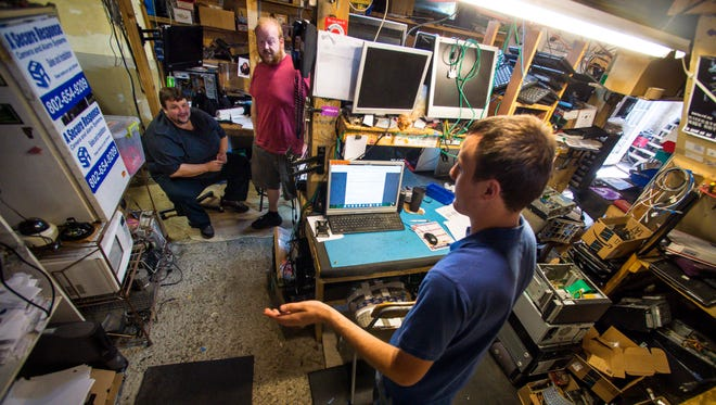 Dennis Woodman, from left, Alex George and Tim West troubleshoot a problem at All Systems Repair in Winooski on Thursday, August 11, 2016.