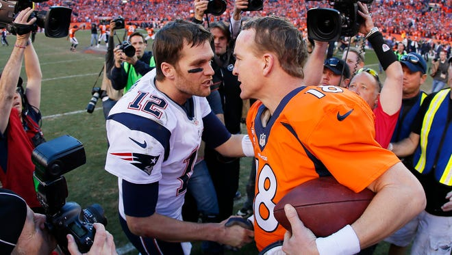 Tom Brady (12) of the New England Patriots congratulates  Peyton Manning of the Denver Broncos after the Broncos defeated the Patriots 26 to 16 during the AFC Championship game at Sports Authority Field at Mile High on January 19, 2014 in Denver, Colorado.