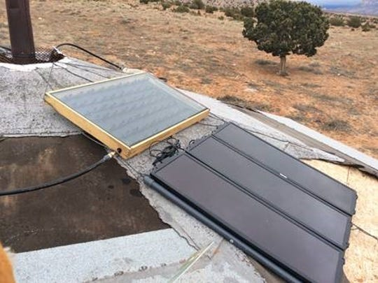 A solar panel portion of Kelly Charley's solar heater is shown on a hogan at her grandparent's property on Feb. 4 in Sweetwater, Ariz.