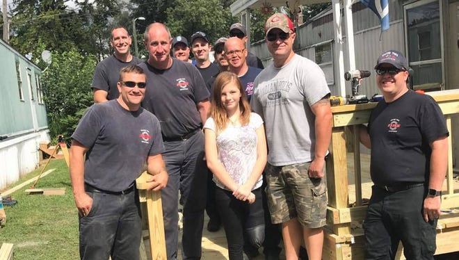 Responders from Wayne Township Fire Department, Indianapolis Metropolitan Police Department and Wayne Township Trustee Andy Harris built a ramp for Breanna Brooks, who lost her leg when struck by a train on Aug. 7, 2017.