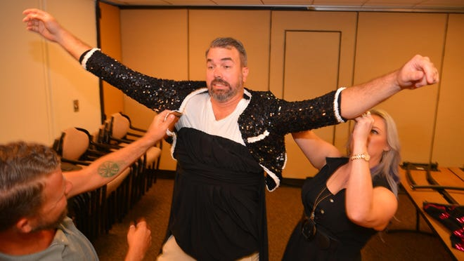 """Susan Naylor and LG Donovan help Gary Neal try on dresses and perfect his dance moves for the upcoming fundraiser """"Dude Looks Like a Lady"""" to support the Womenâ's Center. He is going to be Katy Perry."""