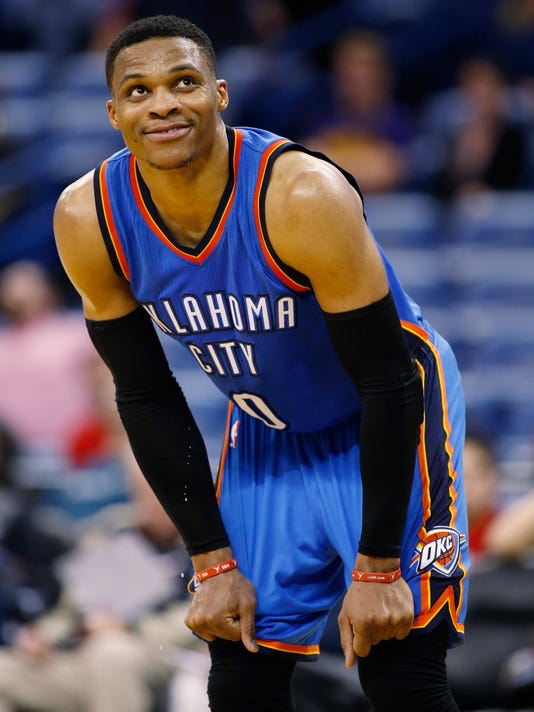 Oklahoma City Thunder guard Russell Westbrook (0) smiles as he checks the score board in the final seconds of an NBA basketball game against the New Orleans Pelicans in New Orleans, Wednesday, Jan. 25, 2017. Oklahoma City won, 114-105. (AP Photo/Max Becherer)