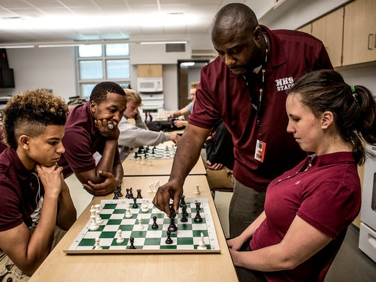 Terrell White and Kenya Black, both Linkage Coordinators at Newark High School, help guide Jayden Morrison and Erin McIntyre through a game of chess.  The students are taking part in Academic Opportunity for Success, a program through Newark City Schools, works with students who are at risk of not graduating. On Wednesdays they play chess which helps to teach the students consequences of good and bad decisions.