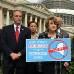 Democratic Rep. Louise Slaughter speaks out against the Trans-Pacific Partnership on Capitol Hill on March 23, 2016. To her left is Republican Rep. Chris Collins.