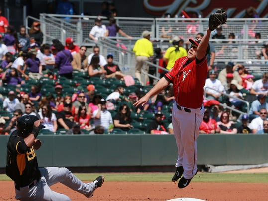 VICTOR CALZADA-EL PASO TIMES El Paso second baseman Taylor Lindsey leaps to snag an errant throw on a steal attempt by Salt Lake's Alfredo Marte Tuesday.