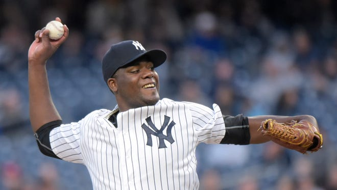 New York Yankees pitcher Michael Pineda delivers the ball to the Oakland Athletics during the first inning of a baseball game Tuesday, April 19, 2016, at Yankee Stadium in New York.