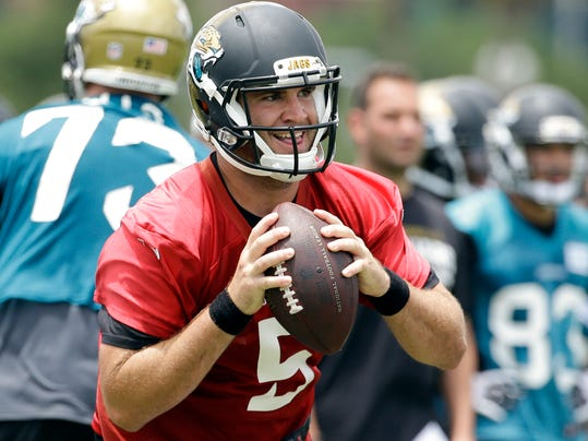 FILE - In this June 18, 2014, file photo, Jacksonville Jaguars quarterback Blake Bortles (5) looks for a receiver during a scrimmage at NFL football minicamp in Jacksonville, Fla. The Jaguars are trying to build a better team around Bortles, with the belief that he will be better served by being inserted into an already-cohesive offense. (AP Photo/John Raoux, File)