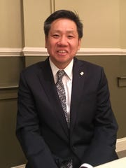 Chan Park, of Henry County, poses for a photo at a