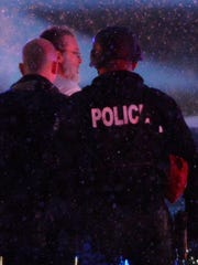 Police take a man into custody near a Planned Parenthood clinic Friday.