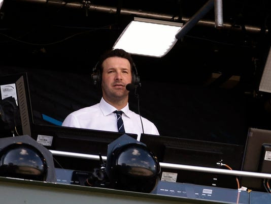 FILE - In this Sept. 24, 2017, file photo, Tony Romo in the broadcast booth during the first half of an NFL football game between the Green Bay Packers and the Cincinnati Bengals in Green Bay, Wis. Romo, the Dallas franchise leader in passing yards and touchdowns, will soon call his first Cowboys game as the lead analyst for CBS. (AP Photo/Mike Roemer, File)
