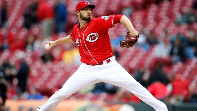 Reds starting pitcher Tim Adleman throws to the Pirates in the first inning.